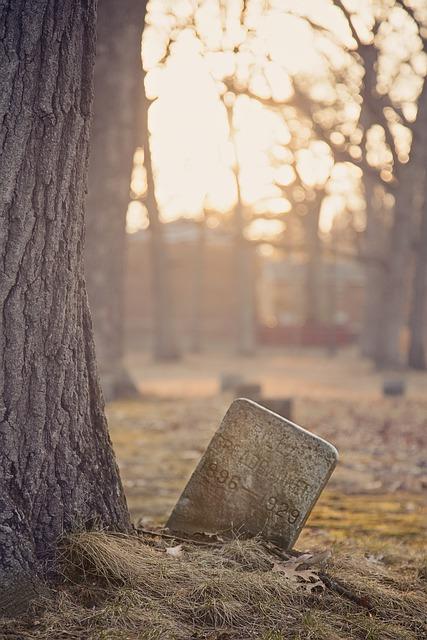 tombstone in graveyard