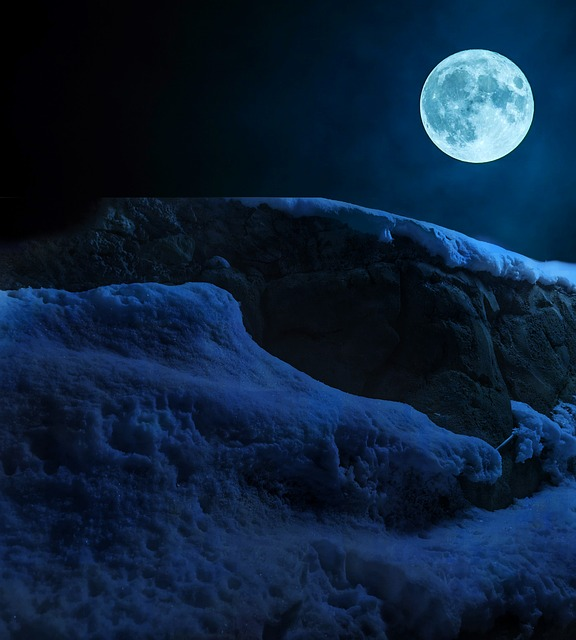 full moon and snowy mountains